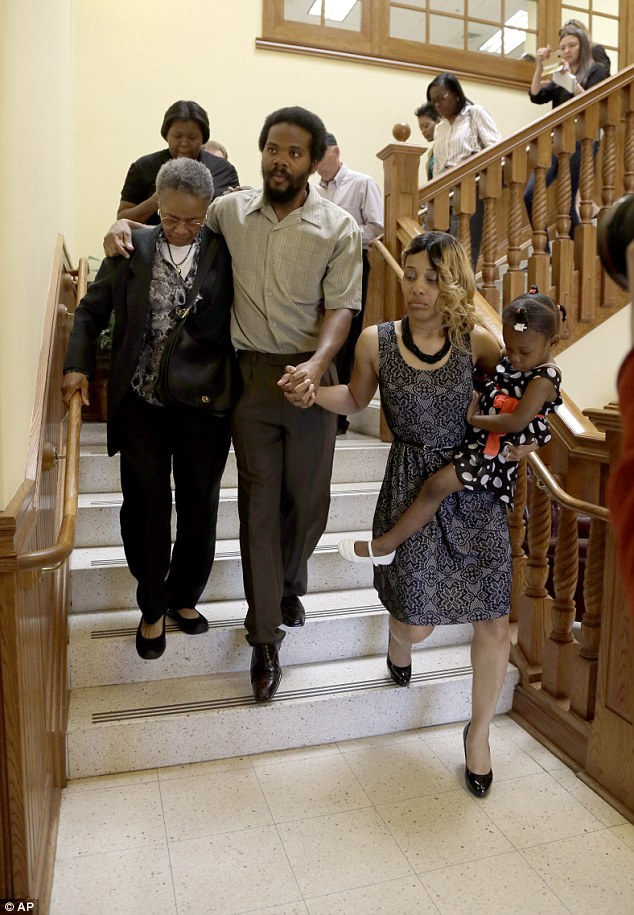 Nightmare over: Anderson, his grandmother (left), wife LaQonna (right) and daughter Nevaeh walk down the stairs and out of court today
