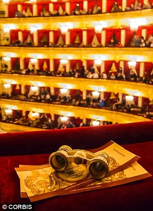 Reasons someone may buy a life experience, such as opera tickets pictured, that doesn't reflect their personality includes a desire to fit in with others