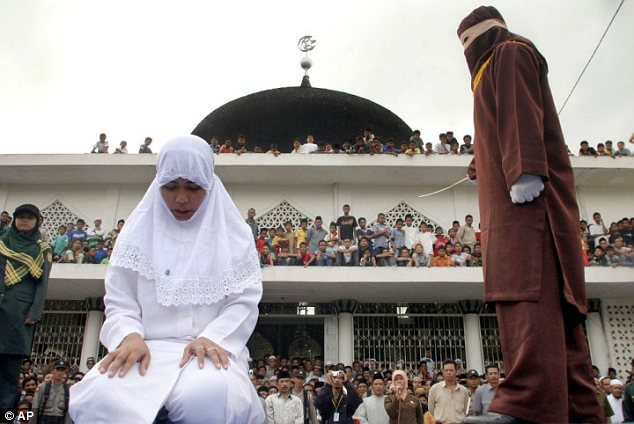 Public punishment: The 25-year-old woman faces up to nine strokes of the cane in Banda Aceh province