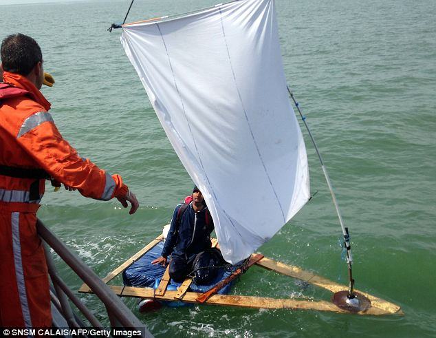If you got points for effort... French coast guard rescue Asif Hussein Khail who tried to cross the Channel on a makeshift raft using a bedsheet as a sail