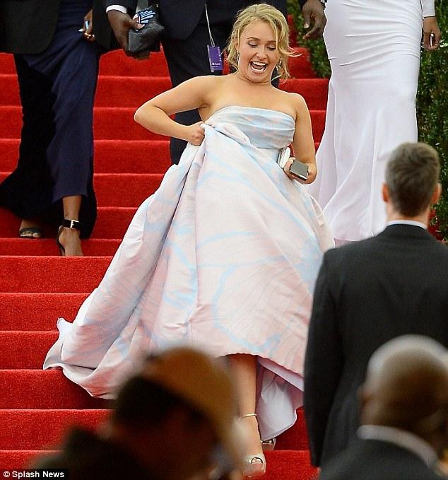 Taking no chances: Hayden hoisted her skirt up to complete her descent