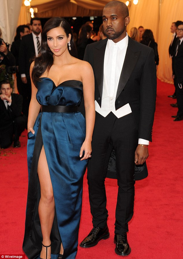 Setting it afire: Kanye and Kim smouldered as they arrived
