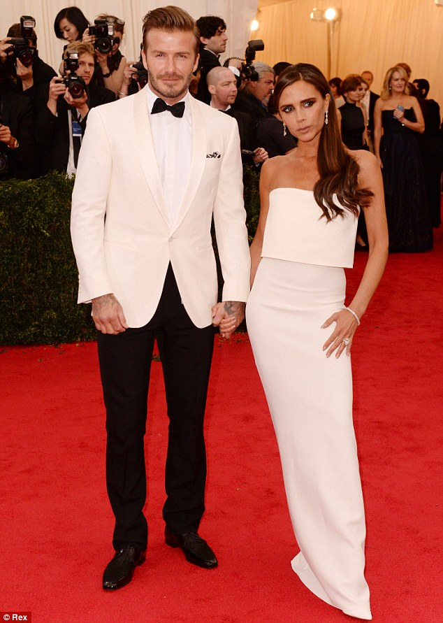 Sleek: Victoria Beckham looked posh alongside husband David Beckham in a form-fitted white gown that showed off her very slender figure
