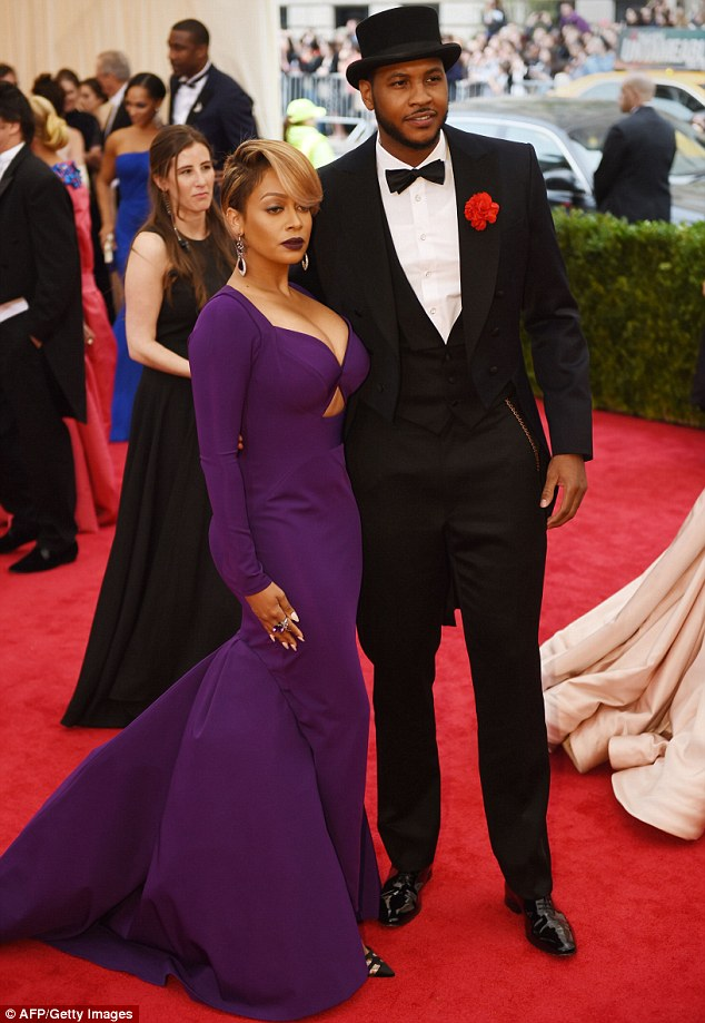 Sophisticated: New York Knicks NBA player Carmelo Anthony appeared aristocratic next to wife LaLa in a black suit with a black top hat