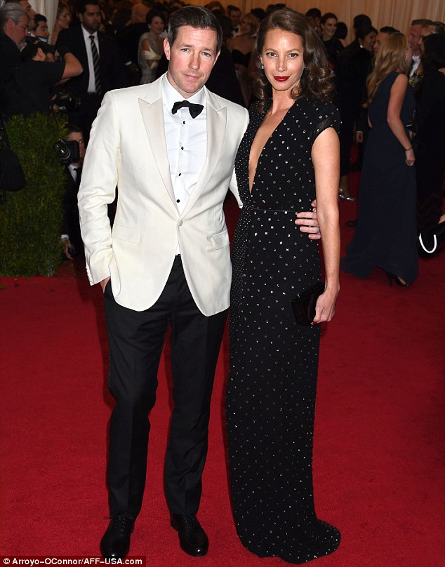 Sparkling: Christy Turlington-Burns appeared radiant alongside husband Ed Burns, in a rhinestone studded black gown with a plunging neckline