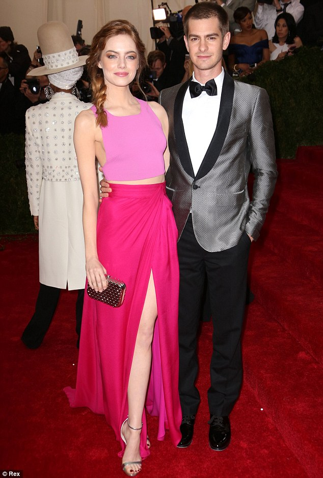 Pretty in pink: Emma Stone and Andrew Garfield served up a striking colour contrast, with the 25-year-old actress donning a bubble gum pink crop top with a flowing hot pink skirt featuring a thigh-high slit