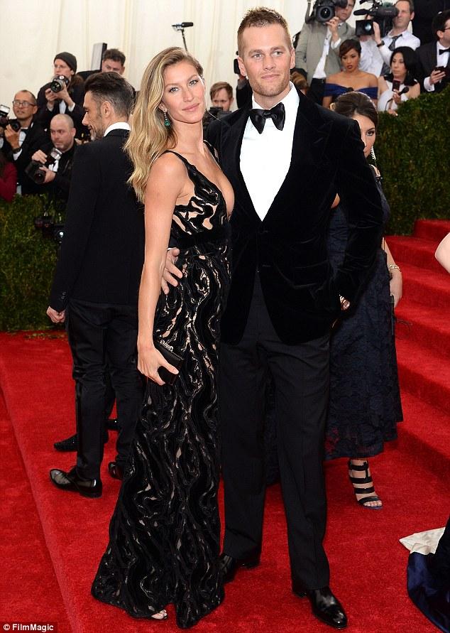 Back in black: Gisele Bundchen dazzled next to husband Tom Brady in an elegant black gown featuring an elaborate design