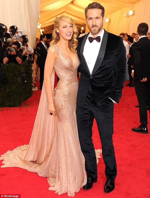 Extravagant: Blake Lively looked like a goddess alongside Ryan Reynolds in a sweeping cream coloured and gold gown, with her hair styled in luxurious 1920s inspired waves