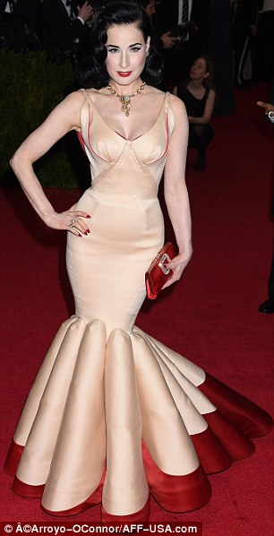 White wonderland: Dita Von Teese mixed it up in a cream and red Zac Posen, while Victoria Beckham went classic and crisp