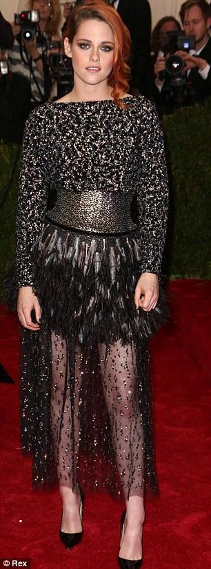 All black babes: Kristen Stewart wore an edgy Chanel frock, while Kristen Wiig also went for a dark option