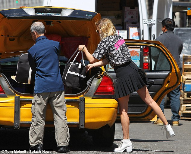 Finally: The star eventually managed to get a taxi and then helped the driver to put her huge amount of luggage into the car