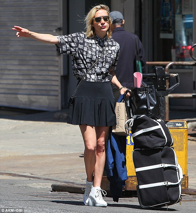 Taxi time: Chloe looked keen to reignite her modelling career as she appeared to be doing a fashion shoot while waiting for a taxi in New York ahead of the Met Gala