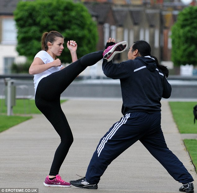 Steely concentration: Imogen high kicks her way to weight loss