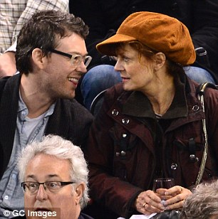 Her beau: The 67-year-old star in an orange version of the same lid with Jonathan in April