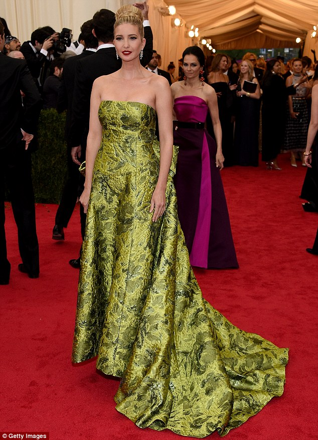 Going glam: The busy mother-of-two - who gave birth to son Joseph in October - wore a green floral Oscar de la Renta gown to the Gala, which she paired with red lipstick and a chic updo