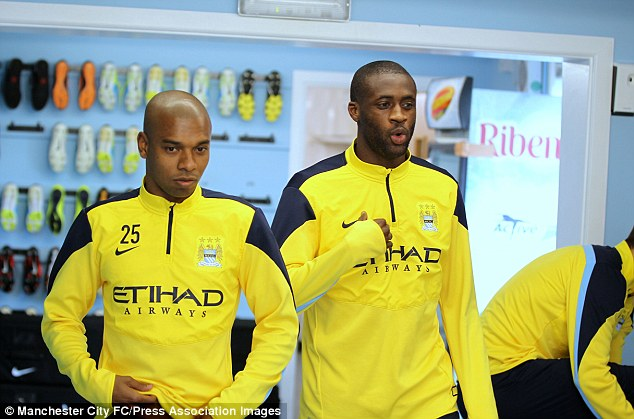 Favourite: Scolari is a big fan of Lucas Leiva, but he may be pipped by Manchester City's Fernandinho (below)