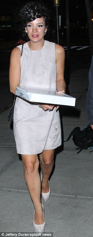 Hope it's not expensive: Lily also managed to spill sauce on her grey shift dress, on the bottom left hand corner