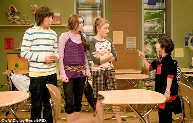 Claim to fame: Arias (right) is known for playing Rico on Hannah Montana alongside Miley Cyrus
