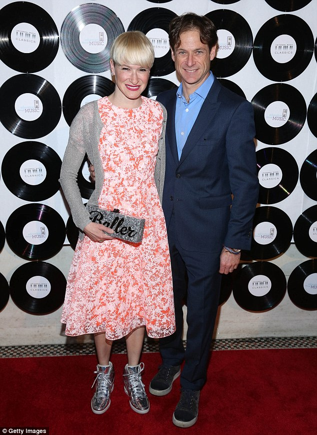 Complementary couple: The bubbly blonde toned down her enthusiasm as she posed with husband Billy Macklowe, with the investment banker displaying his complementary style by teaming a smart blue suit with lighter blue open-collared shirt and scruffy black sneakers