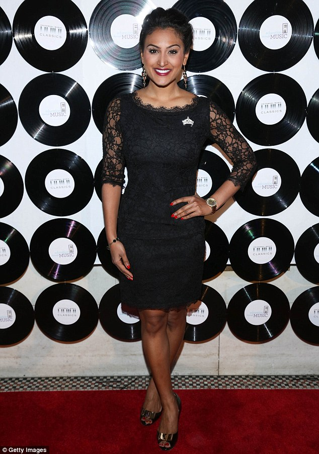 Lovely in lace: Miss America 2014 Nina Davuluri proudly wore her crown pin on the chest of her black lace dress, which featured pretty sheer three-quarter sleeves