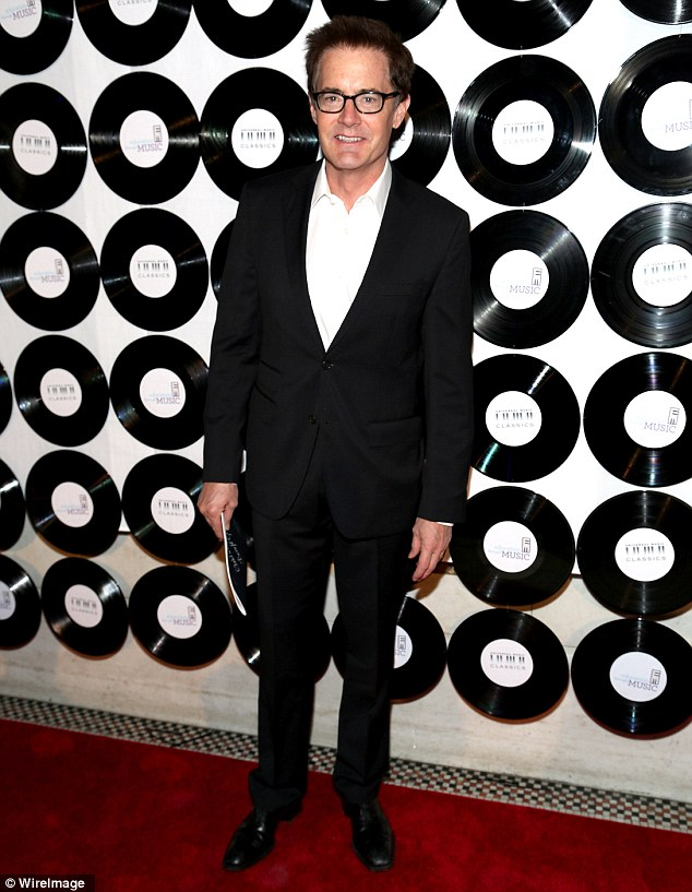 Dressed to impress: Kyle MacLachlan was dapper in his black suit, which he wore with an open-collared crisp white shirt