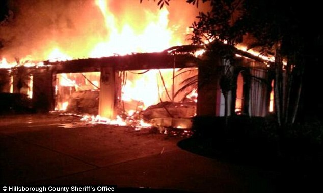 Fire: The blaze was so ferocious on May 7 that firefighters could not get in to examine the grisly scene until the next day