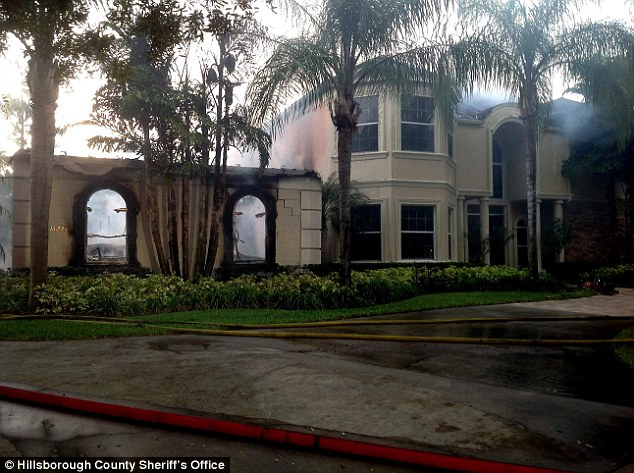 Scorched: At least three people were discovered dead in the lavish home, pictured