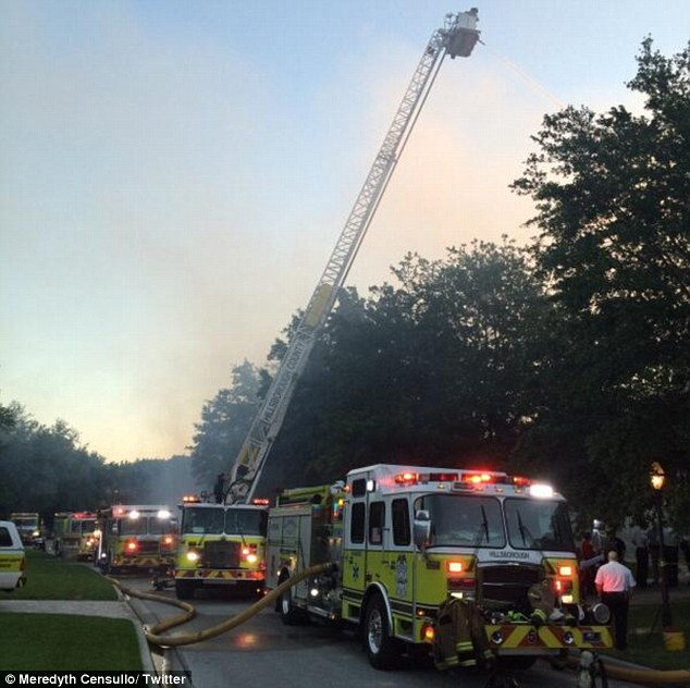 Crews: Emergency crews rushed t the property, pictured, after 911 calls were made before 6a.m.