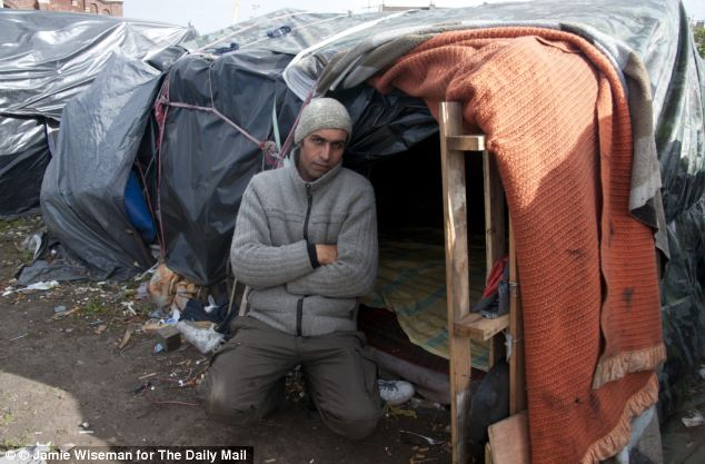 Afghan migrant Asif Hussainkhil with his makeshift tent in Calais, France, where he was returned by coastguards after his latest attempt to cross the Channel. He has vowed to build a new boat.