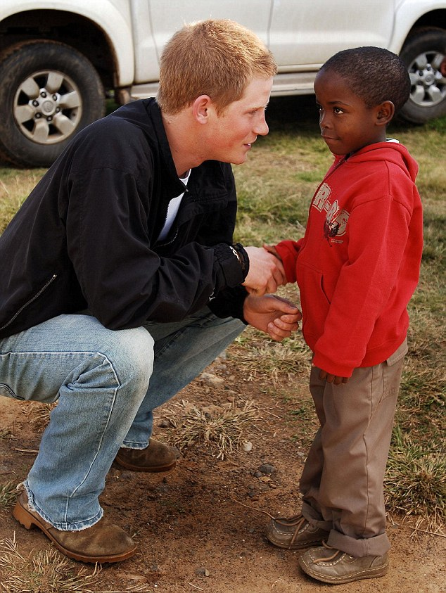 Prince Harry shakes hands with an old friend, Mutsu Potsane, six, in the grounds of the Mants'ase children's home, while on a return visit to Lesotho in southern Africa as he launched his charity called Sentebale, which means 'Forget me not' in memory of his mother Diana, Princess of Wales