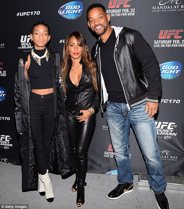 Trusting parents: Willow with Jada and Will at a UFC event in Las Vegas in February