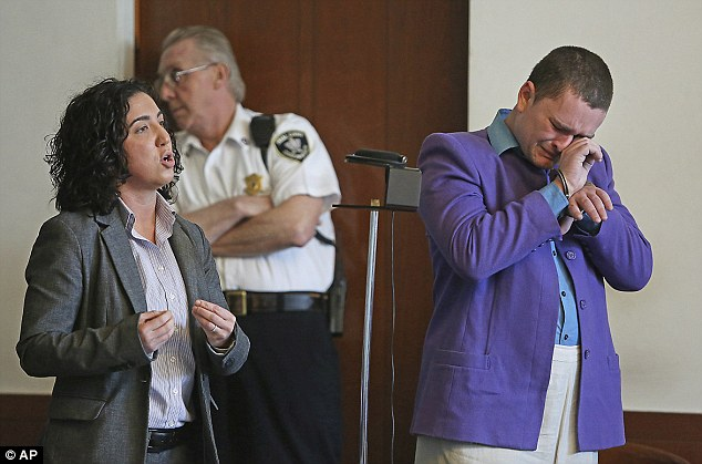 Brought to tears: Kevin Edson, 25, cries during a hearing as he stands beside his attorney, Shannon Lopez, left, in Municipal Court Wednesday, May 7