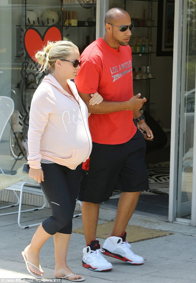 '[Hank] makes sure each day is perfect!' The Splash star covered her prominent bump in a comfy pink hoodie and wore black capri leggings and white flip-flops