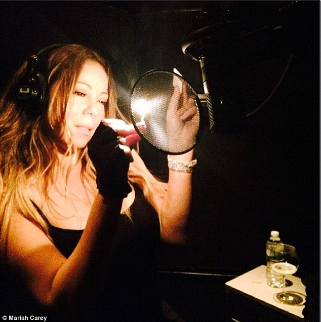 Spark to a flame: Mariah was seen lighting up a match in the recording studio in a new Instagram snap