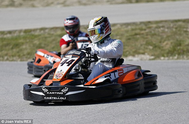 Still got it: Hamilton relived his days as a champion go-karter at the CastellolÌ circuit with his trademark No 44