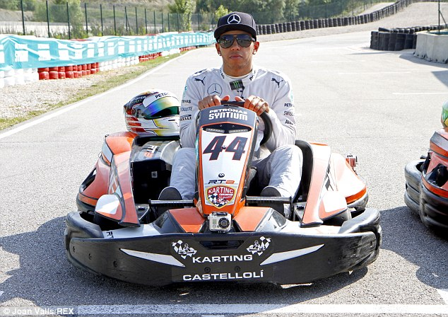 In the hot seat: Lewis Hamilton gave a go-karting masterclass near Barcelona ahead of the Spanish Grand Prix