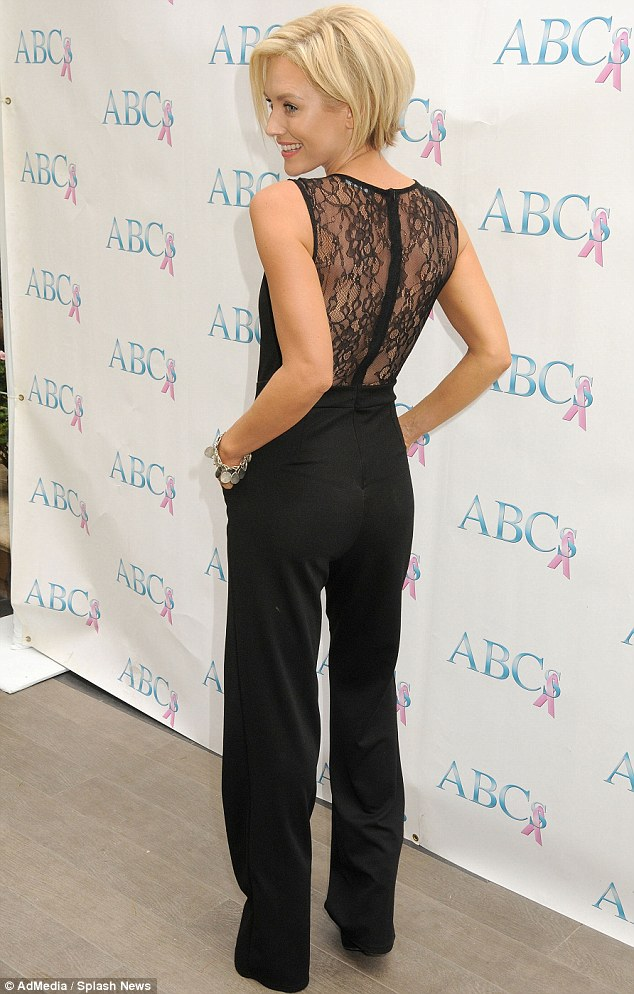 Backless babe: The blonde beauty showed off some skin in a black lacy top