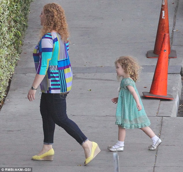 Gorgeous: The little one wore a cute frilled turquoise dress with silver shoes