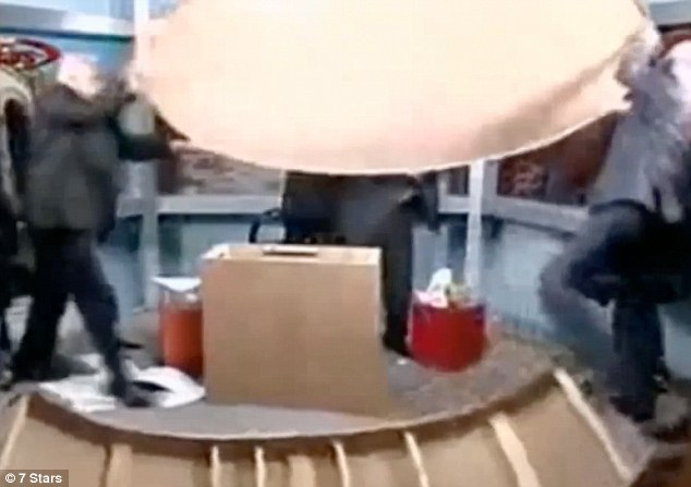 Violent: After the verbal altercation, the two men then lifted the desk up and started using it as a weapon against one another while the host watched in horror