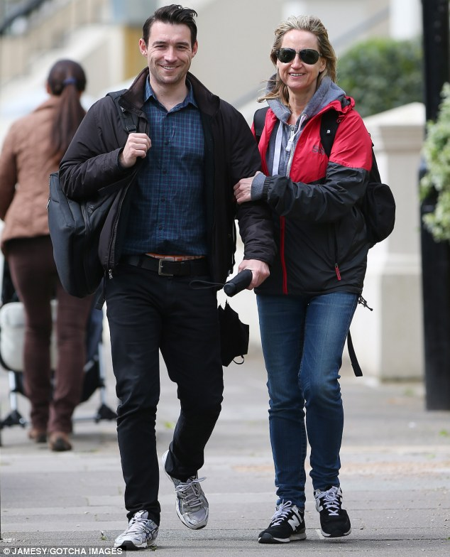 All smiles: Carol McGiffin and fiance Mark Cassidy stayed close as they took a walk in the sunny weather in the capital on Tuesday