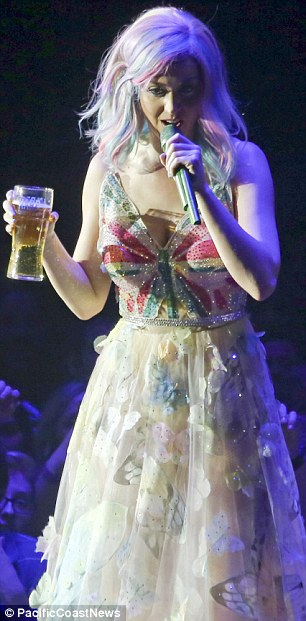 Fancy a pint? Katy held up the glass of beer on stage  but only managed a couple of sips