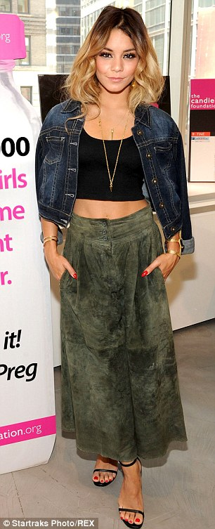 Displaying her flat tummy: The 25-year-old wore a crop top and green skirt to the event