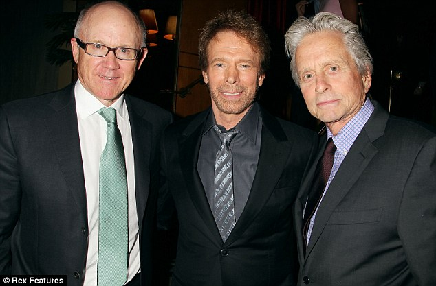 All hands on deck: Michael, pictured with Bruckheimer and Woody Johnson, was just one of the many on hand to support the launch of the Michael Singer-written book about the director's top films including Top Gun
