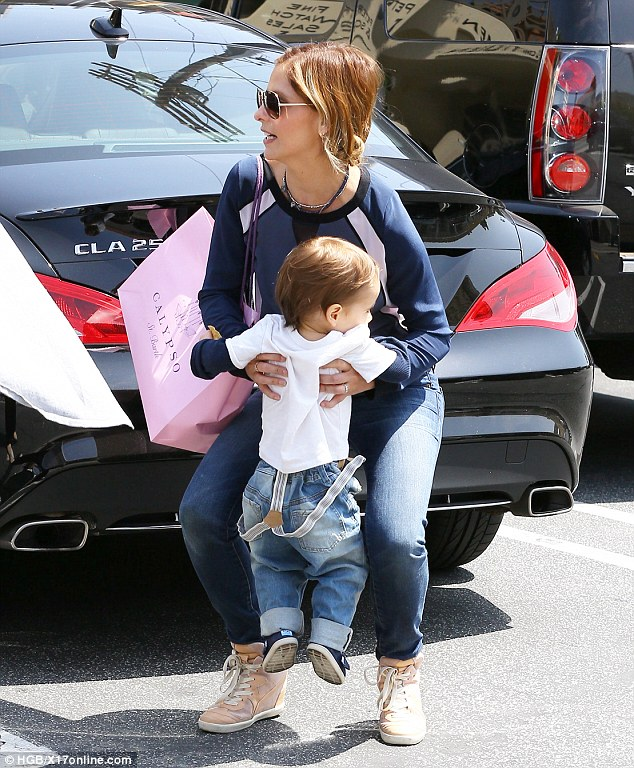 Catching a lift: While little Rocky was determined to walk on his own, as they approached the carpark the actress scooped him up into her arms
