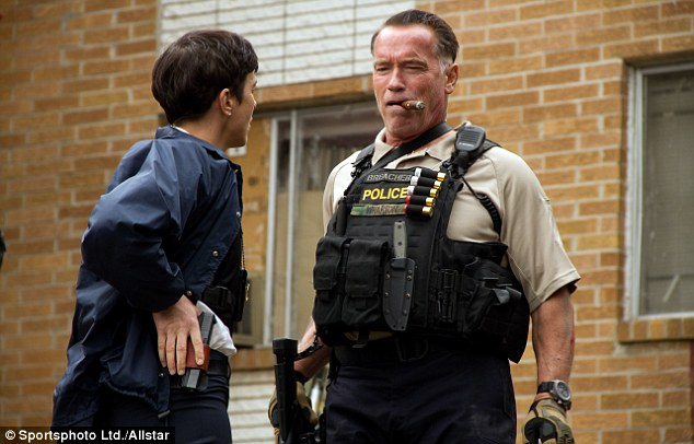 Tooled up: Arnold Schwarzenegger and Olivia Williams are unlikely companions in Sabotage