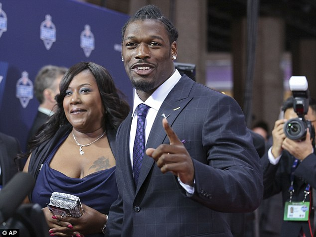 South Carolina defensive end Jadeveon Clowney arrives for the first round of the 2014 NFL Draft with his mother Josenna Clowney