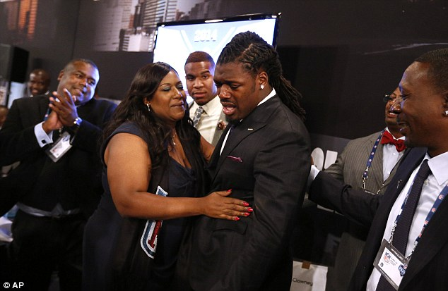 Jadeveon Clowney, from South Carolina, becomes emotional with his mother Josenna Clowney after being selected number one overall by the Houston Texans in the first round of the NFL football draft