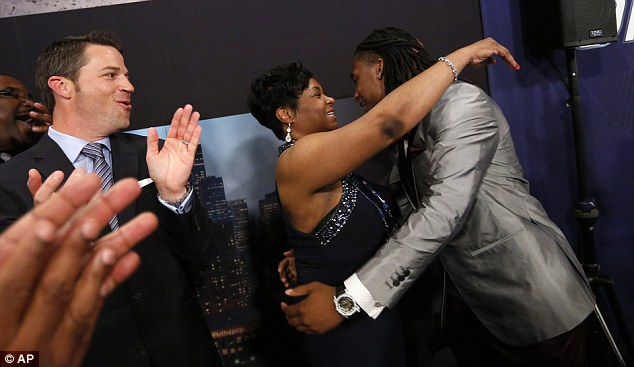 Bradley Roby, from Ohio State, hugs his mother Betty Roby after being selected 31st overall by the Denver Broncos