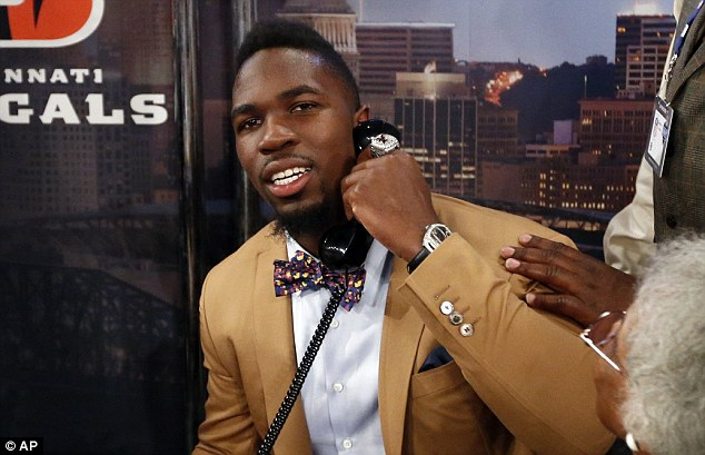 C.J. Mosley, from Alabama, takes a call before being selected 17th overall by the Baltimore Ravens in the first round of the NFL football draft on Thursday at Radio City Music Hall