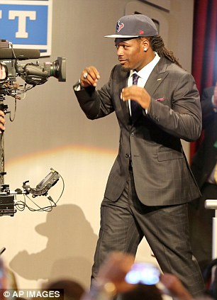 Number one! South Carolina defensive end Jadeveon Clowney reacts after being chosen as the first pick in the first round of the 2014 NFL Draft in New York
